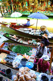 SAMUTSONGKRAM, THAILAND. AUGUST 18 : Unidentified tourists and vendors in Amphawa floating market on August 18, 2007 in Stock Photos
