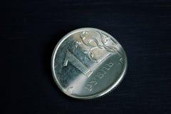 Sanções e conceito da inflação Rublo de Bent Russian no fundo escuro fotos de stock