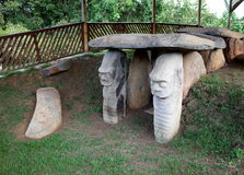 San Agustin Archeological Park. Ancient pre-Colombian megaliths stand guard outside a tomb at San Agustin Archeological Park in Colombia stock image