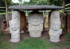 San Agustin Archeological Park. Ancient pre-Columbian megaliths stand guard outside a tomb at San Agustin Archeological Park in Colombia stock photography