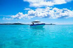 SAN ANDRES, COLOMBIA - OCTOBER 21, 2017: Amazing beautiful view of a man sailing in a boat in an gorgeos blue water, San. Andres Island during a sunny day in Stock Photo