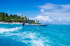 SAN ANDRES, COLOMBIA - OCTOBER 21, 2017: Amazing beautiful view of a man sailing in a boat in an gorgeos blue water, San. Andres Island during a sunny day in Stock Image