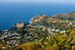 San Angelo view. Picture was taken near San Angelo, Italy, Ischia, Camania. Aerial view with lot of green vegetation, vivid blue sea and clear sky Stock Photos
