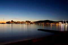 San Antonio Bay also known as Sant Antoni de Portmany in Ibiza, Spain by Twilight. To the right of the image a small jetty comes out to sea, to the left San stock photo