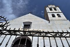 San Antonio church and art iron bars  in Frigiliana - Spanish white village Andalusia. Beautiful and charming with its narrow streets and footpaths white village Royalty Free Stock Photos