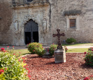 San Antonio Mission San Juan in Texas. View of the garden and cross in front of the Mission Espada near San Antonio in Texas royalty free stock photos