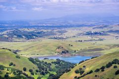 San Antonio reservoir surrounded green hills, California. View towards San Antonio reservoir surrounded green hills; Pleasanton and Mt Diablo in the background royalty free stock photography