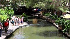 San Antonio River walk 7709. Colorful view of a tree lined section of the landmark San Antonio River Walk in San Antonio, Texas. People enjoying a lazy summer stock video
