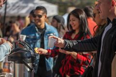 SAN ANTONIO, TEXAS - JANUARY 6, 2018 - Selective focus with accent on hand and cup of people getting coffee during the 2018 Coffee. Festival held at La Villita Royalty Free Stock Photos