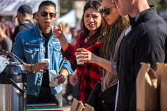 SAN ANTONIO, TEXAS - JANUARY 6, 2018 - Selective focus with accent on hand and cup of people getting coffee during the 2018 Coffee. Festival held at La Villita Royalty Free Stock Photography