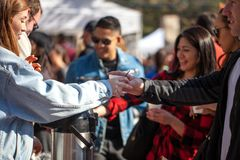 SAN ANTONIO, TEXAS - JANUARY 6, 2018 - Selective focus with accent on hands and cup of people getting coffee during the 2018 Coffe. E Festival held at La Villita Royalty Free Stock Photo