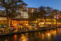 SAN ANTONIO, TEXAS - NOVEMBER 27, 2017 - People have diner and drinks on the Riverwalk in San Antonio decorated with Christmas lig Stock Photo