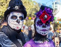 SAN ANTONIO, TEXAS - OCTOBER 28, 2017 - Couple wears face paint and hats decorated with flowers and skulls for Dia de los Muertos/. Couple wears face paint and Royalty Free Stock Image