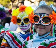 SAN ANTONIO, TEXAS - OCTOBER 28, 2017 - Girls wearing colorful masks and traditional costumes for Dia de Los Muertos/Day of the De. Girls wearing colorful masks stock photography