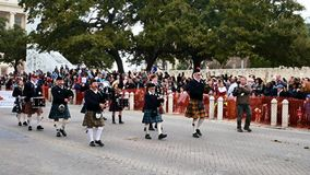 San Antonio, Texas USA - February 3 2018: Bagpipes and drums band marches past the Alamo. As part of parade celebrating Rodeo stock video