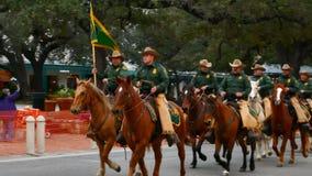 San Antonio, Texas USA - February 3 2018: Border patrol officers ride horses past The Alamo stock footage