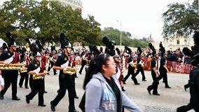 San Antonio, Texas USA - February 3 2018: High school band marches past the Alamo. San Antonio, Texas USA - February 3 2018: High school band marches past the stock footage