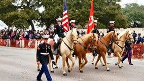 San Antonio, Texas USA - February 3 2018: Marine Corps members ride horses in formation past The Alamo stock video