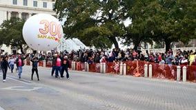 San Antonio, Texas USA - February 3 2018: Rodeo parade marchers display San Antonio 300 Years at The Alamo stock video