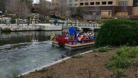 San Antonio, TX - 14 Feb 2015:  Tour boat with passengers on River Walk. San Antonio, TX - 14 Feb 2015:  Tour boat with passengers on River Walk leave The Pearl stock video
