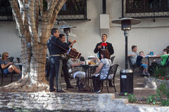 San Antonio, TX/USA - circa November 2015: Mexican Band plays for tourists inside the restaurant at River Walk in San Antonio Royalty Free Stock Photography