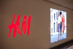 SAN ANTONIO, USA - APRIL 18, 2018 - H&M logo next to a large screen inside store. H & M Hennes & Mauritz AB is a Swedish multinati. Onal retail-clothing company Stock Photo
