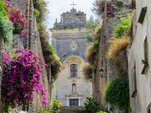 San Bartolomeo, Lipari Cathedral. View of the facade of Lipari Cathedral surrounded by flowers and trees. In Lipari, Aeolian Islands, Italy Royalty Free Stock Images