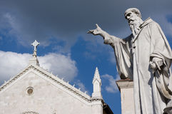 San Benedetto a Norcia. Statue and the basilica of St. Benedict of Norcia Stock Photos