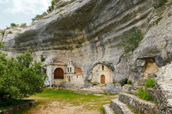 San Bernabe Chapel in Ojo Guarena, Burgos, Spain. San Bernabe chapel is built inside natural caves eroded by Guarena river Stock Photography