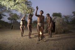 San bush people. Around a fire Royalty Free Stock Photos