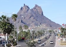 A Scenic View of Tetakawi Mountain Above San Carlos, Sonora, Mex. SAN CARLOS, MEXICO, MARCH 13. The Main Drag on March 13, 2018, in San Carlos, Mexico. A Scenic Stock Photos