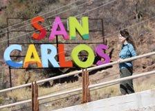 A Woman at a Railing, San Carlos Sign Behind, Sonora, Mexico. SAN CARLOS, MEXICO, MARCH 13. Mario Favio Beltrones Blvd. on March 13, 2018, in San Carlos, Mexico stock photography