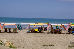 Beach chairs on sandy beach. SAN CLEMENTE ECUADOR, FEBRUARY-2013 Beach chairs on sandy sunny beach Feb 2013 in San Clemente Ecuador.San Clemente is a fishing Royalty Free Stock Photography