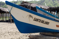Beached Fishing boat in Ecuador. SAN CLEMENTE ECUADOR, FEBRUARY-2013 Fishing boat on shore Feb 2013 in San Clemente Ecuador.San Clemente is a fishing village on Royalty Free Stock Photography
