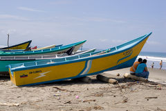 Beached Fishing boat in Ecuador. SAN CLEMENTE ECUADOR, FEBRUARY-2013 Fishing boat on shore Feb 2013 in San Clemente Ecuador.San Clemente is a fishing village on stock images