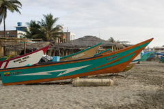 Beached Fishing boat in Ecuador. SAN CLEMENTE ECUADOR, FEBRUARY-2013 Fishing boat on shore Feb 2013 in San Clemente Ecuador.San Clemente is a fishing village on stock image
