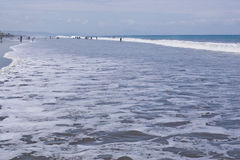 Playing in the surf Ecuador. SAN CLEMENTE ECUADOR, FEBRUARY-2013 Vacationers playing in the surf Feb 2013 in San Clemente Ecuador.San Clemente is a fishing royalty free stock images