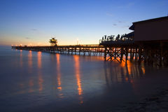 San Clemente Pier at sunset - full. San Clemente Pier at sunset with lights reflected in ocean Royalty Free Stock Images