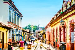 San Cristobal de las Casas, Mexico - April 27, 2016: Tourists walk in pedestrian street, San Cristobal de las Casas royalty free stock photos