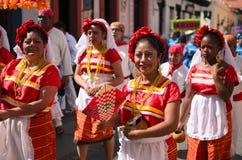 SAN CRISTOBAL DE LAS CASAS, MEXICO, 13 DECEMBER 2015: Women in t. Raditional Chiapas dress walking outdoors Royalty Free Stock Images