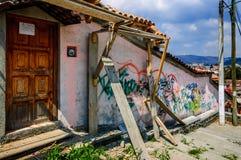 Graffiti in San Cristobal de las Casas, Mexico. San Cristobal de las Casas, Mexico - March 26, 2015: Graffiti on old hilltop house wall royalty free stock photos