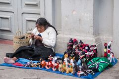 Old chiapas woman sitting on a street ground and doing hand made stock image