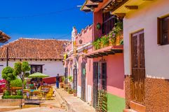 SAN CRISTOBAL DE LAS CASAS, MEXICO, MAY, 17, 2018: Unidentified people eating at outdoor of a restuarant in a colonial royalty free stock photo