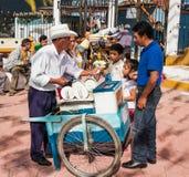 Man selling traditional icecream in San Cristobal de las casas. SAN CRISTOBAL, MEXICO-DEC 11, 2015: Man selling traditional icecream at street market on Dec 11 royalty free stock images