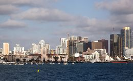San Diego from the bay. Looking across the harbor to the beautiful San Diego skyline on a spring day. The Star of India and the city hall are along the boardwalk Royalty Free Stock Image