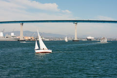 San Diego bay with sailboat and Coronado Bay Bridge Royalty Free Stock Photo