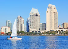 San Diego Bay Scene. San Diego skyline on the Seaport Village side and a sail boat sailing along the bay royalty free stock photo