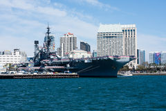 San Diego bay with USS Midway museum and downtown buildings Stock Image