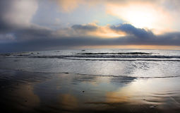 San diego beach. Taken after sunset.  Foggy and low clouds and some birds Royalty Free Stock Photography