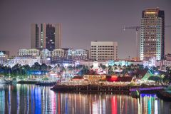 SAN DIEGO, CA - JULY 31, 2017: Night reflections of Downtown San Diego from the city port. The city attracts 10 million tourists stock photography